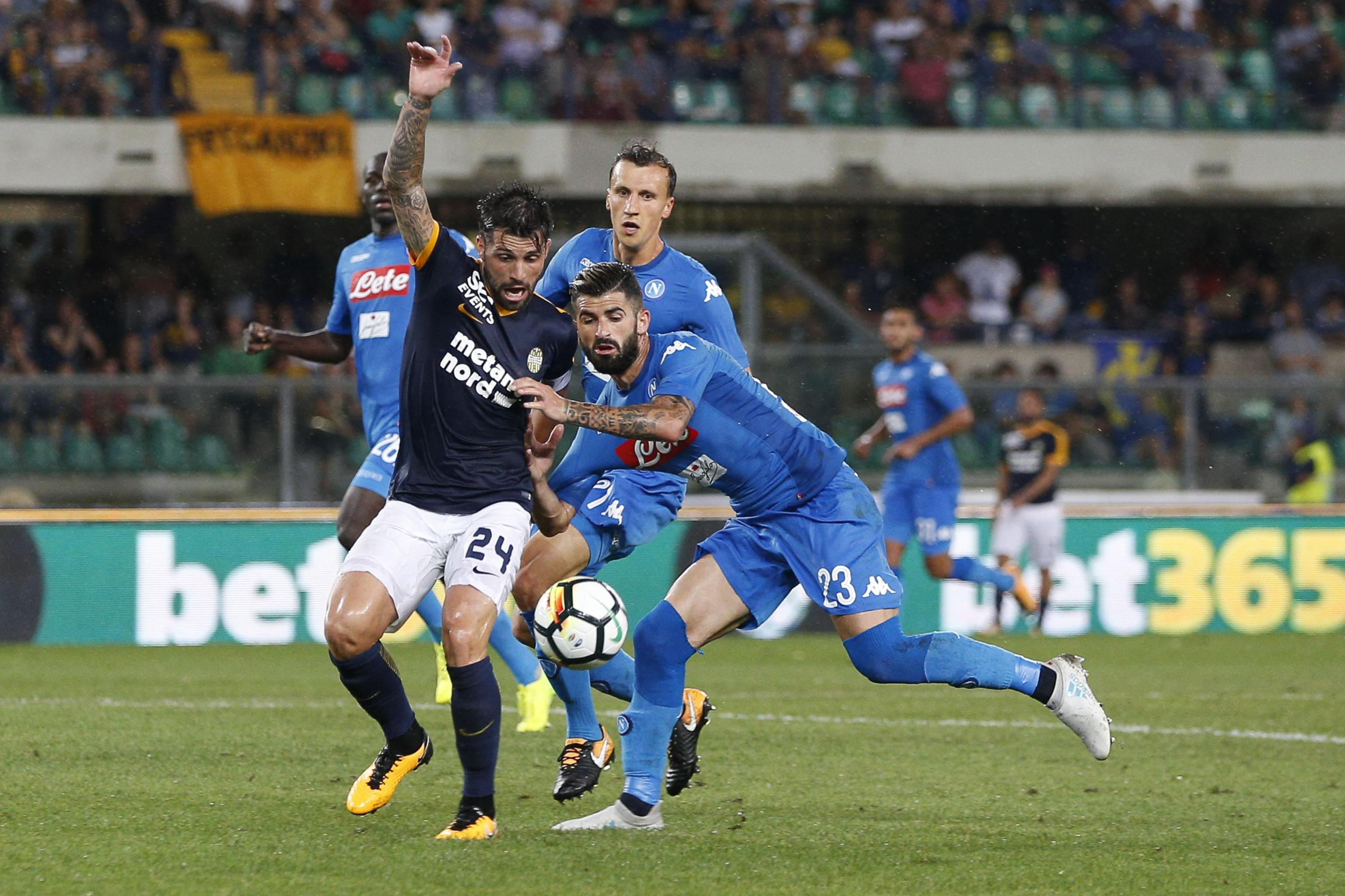Napoli's Elseid Hysaj (right) fouls Hellas Verona's Daniel Bessa during a Serie A soccer match between Hellas Verona and Napoli at the Bentegodi stadium in Verona, Italy on Saturday.