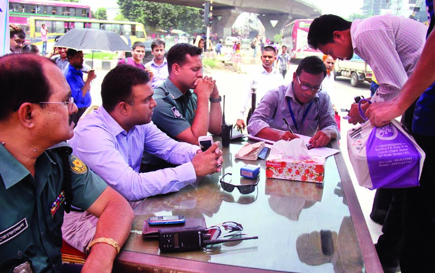 A mobile court of DMP realized Tk 100 per head for not using foot-over bridge for crossing road. The snap was taken from the city's Mohakhali on Monday.