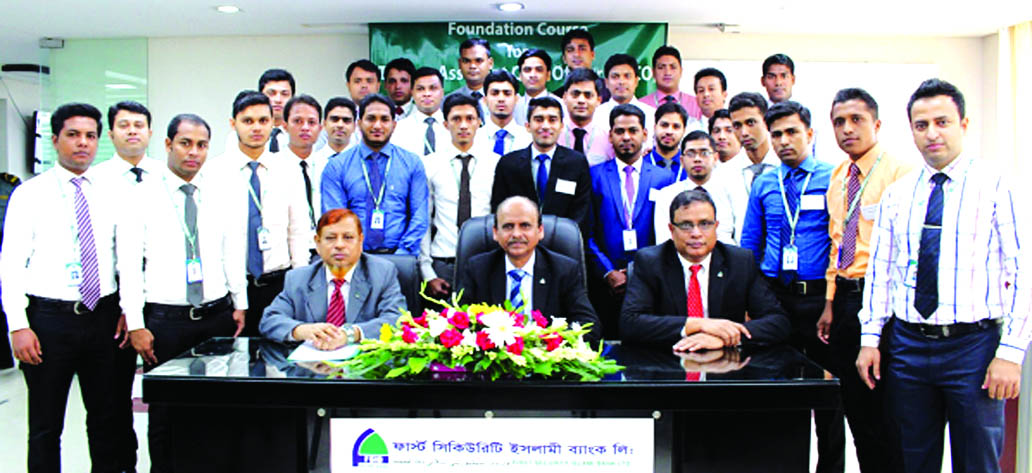 Quazi Osman Ali, Additional Managing Director of First Security Islami Bank Limited, poses with the participants of its 26th Foundation Course of Trainee Assistant Cash Officers at the bank's Training Institute in the city on Thursday. Md. Ataur Rahman, Principal and Muhammad Lutful Haque, Faculty Member of the institute were present.