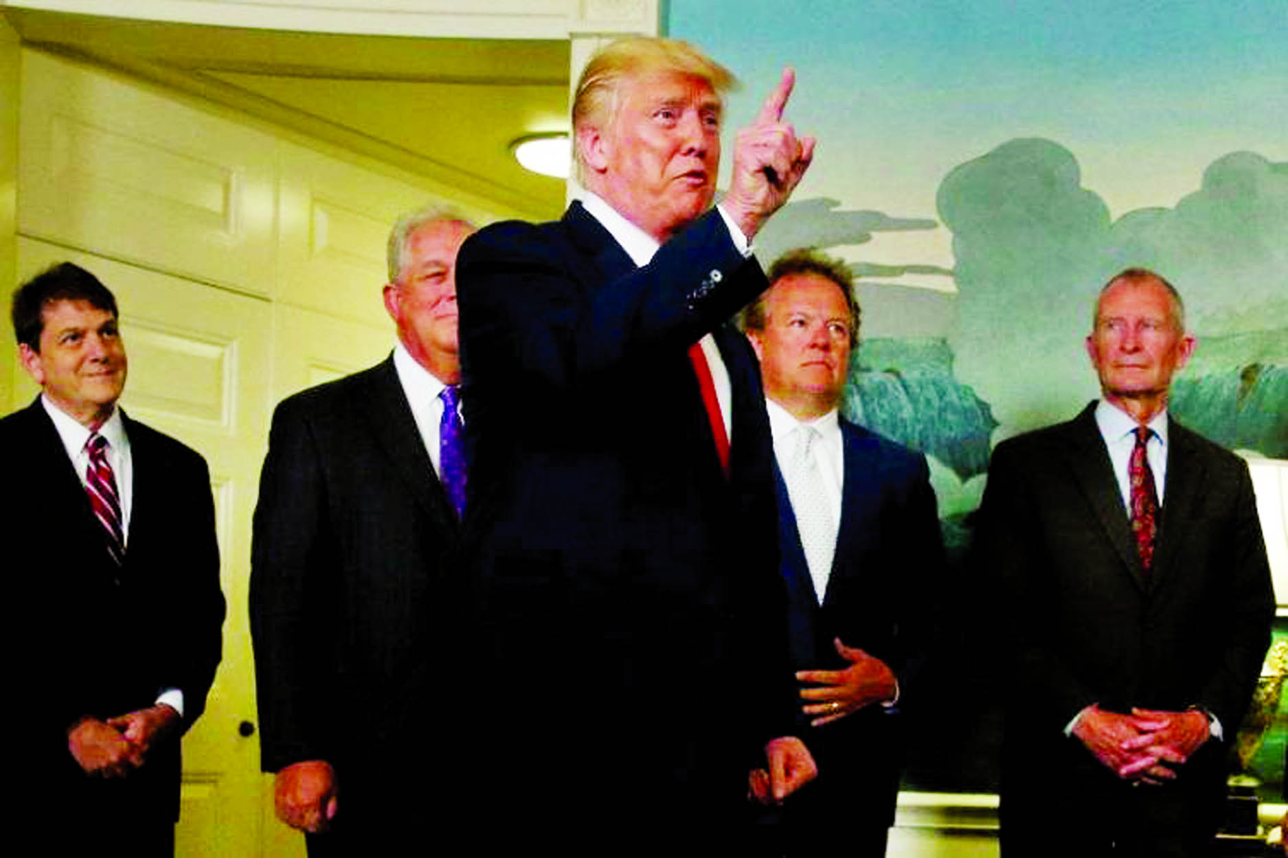 US President Donald Trump responds to a reporter's question after signing a memorandum at the White House in Washington, US.