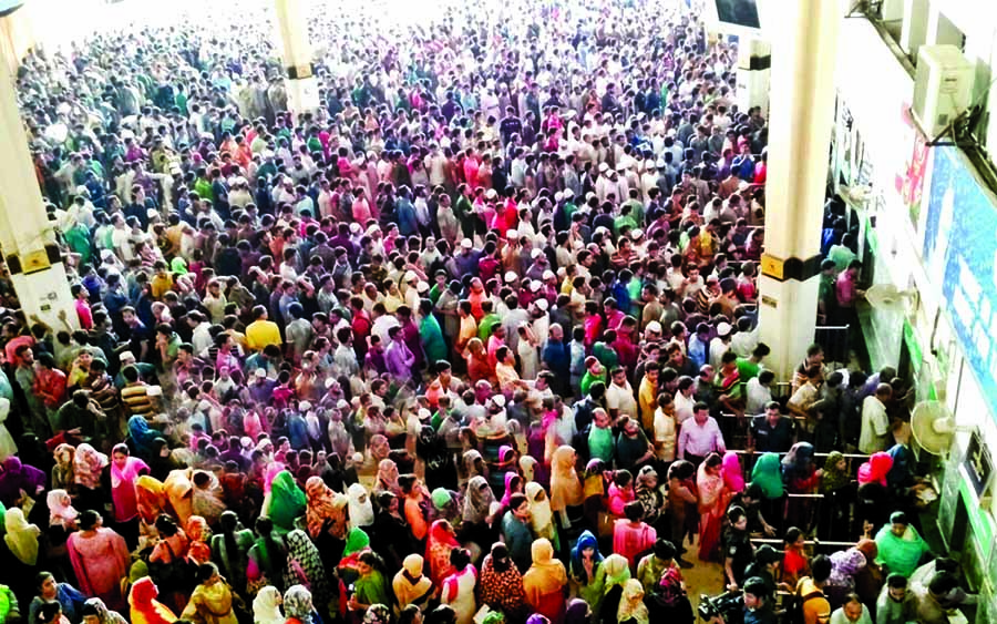 Kamalapur Railway Station is being over crowded by thousands of home-goers for Eid advance tickets. This photo was taken on Monday.