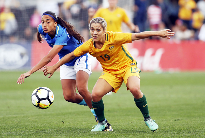 Brazil`s Andressa Alves da Silva (left) fights for the ball against Australia`s Katrina Gorry during their friendly soccer match in Penrith, Australia on Saturday.