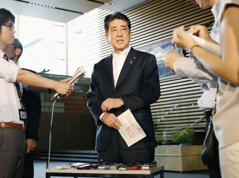 Japan's PM Abe mulling snap election as early as October