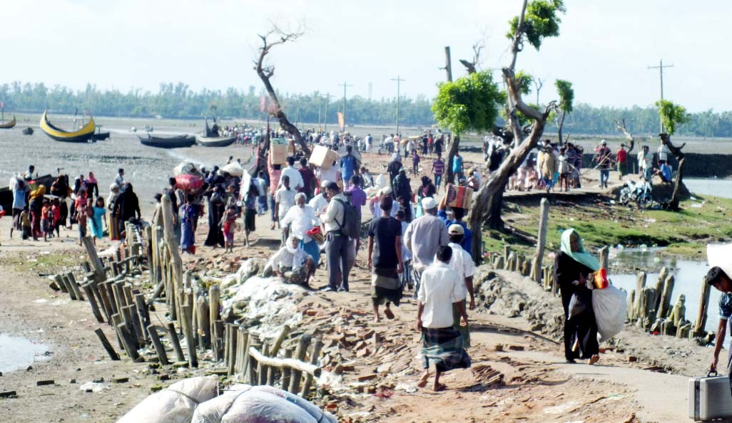 Thousands of Rohingyas are rushing to border to save life. This snap was taken from Shahporir Dwip in Teknaf on Sunday.