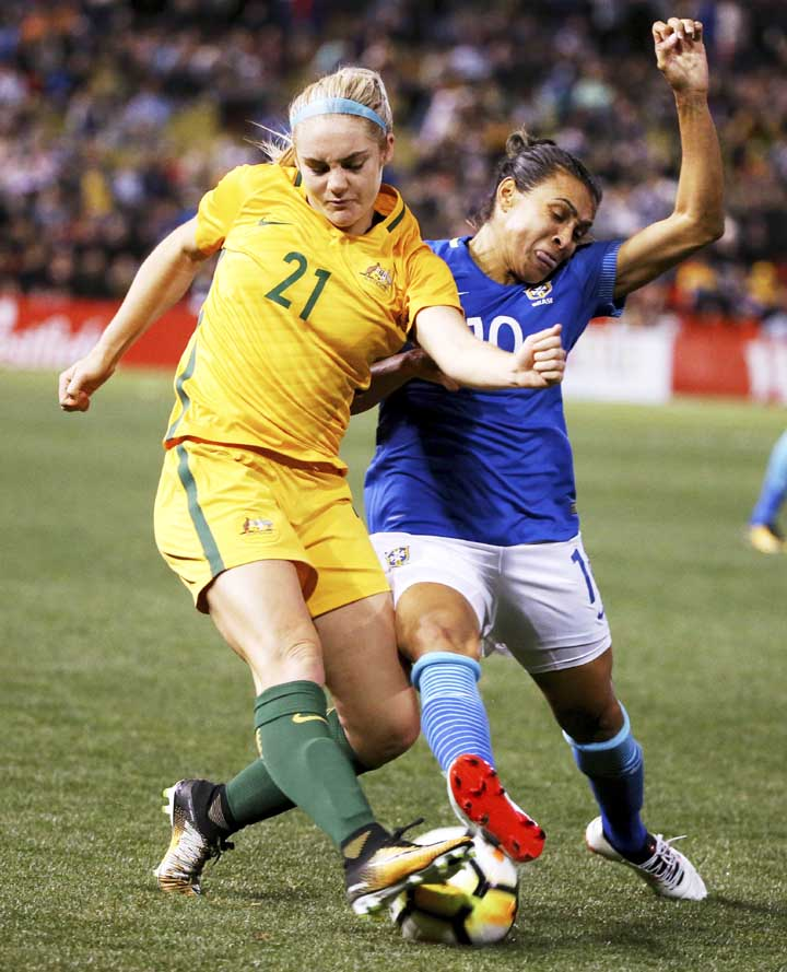 Australia's Ellie Carpenter (left) and Brazil's Marta Vieira da Silva compete for the ball during their friendly soccer match in Newcastle, Australia on Tuesday.