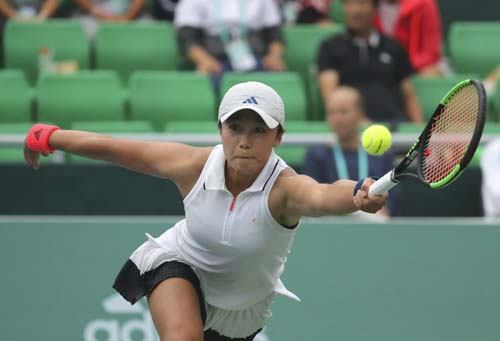 Han Na-lae of South Korea returns a ball to Kristyna Pliskova of the Czech Republic during their first round match of the Korea Open tennis championships in Seoul, South Korea on Tuesday.