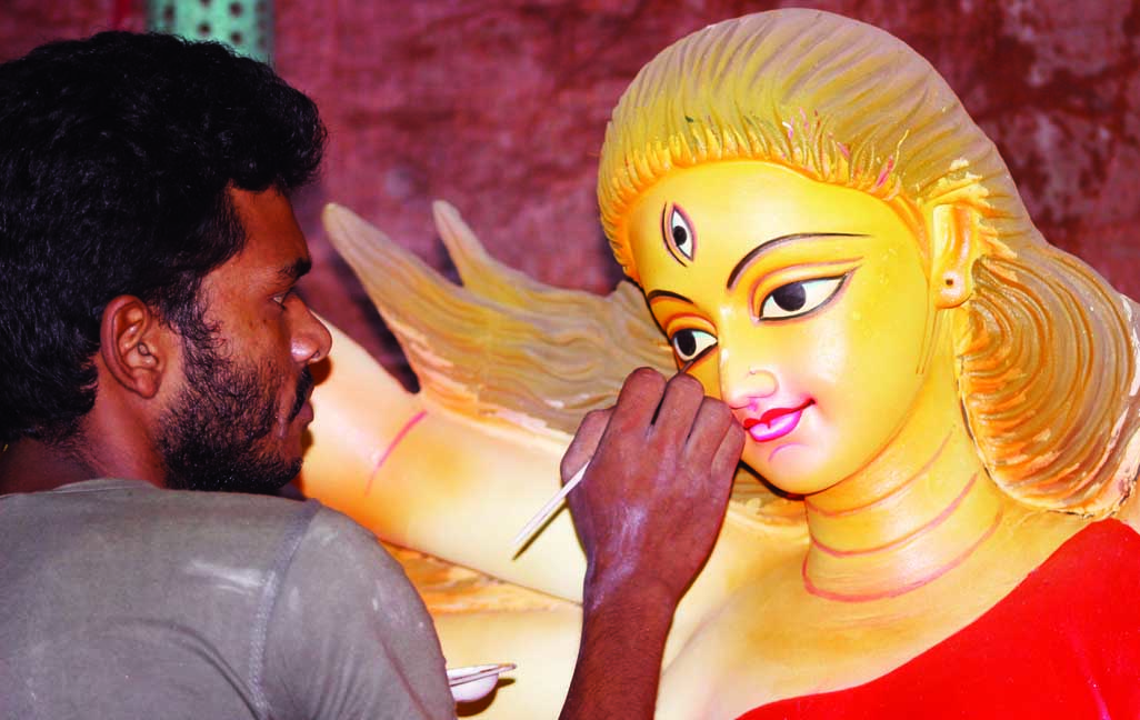 An artist giving final touch to 'Godess' as Durga Puja is coming to nearer. This picture was taken from Zamindar Bari  Mondir in Banglabazar area in the city yesterday.