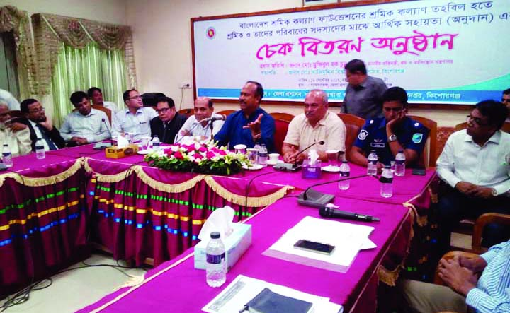 KISHOREGANJ:  State Minister for Labour and  Employment Adv Mujibul Haque Chaunu MP addressing at cheque distribution programme among the poor labourers at Collectorate Conference Room on Tuesday. Md Azimuddin Biswas, DC, Kishoreganj chaired the meeting.