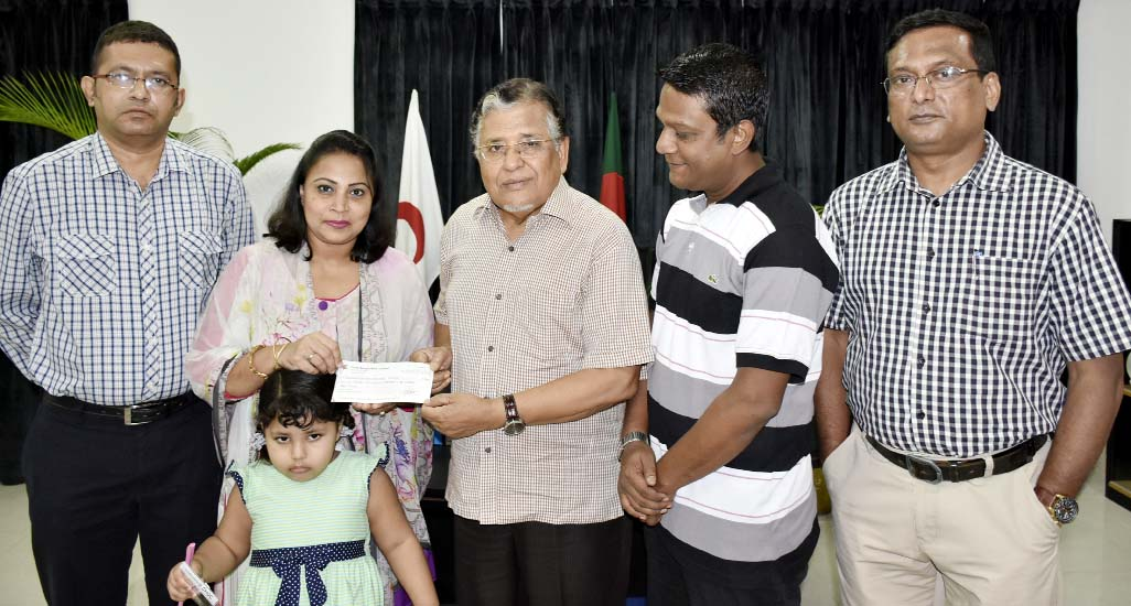 Treasurer of Bangladesh Red Crescent Society Adv Touhidur Rahman receiving   check of donations from Executive Committee Member of Chittagong Red Crescent Society,  Chittagong City Unit H. M Salahuddin at the Chairman's office, National Headquarters yesterday.  Among others, S M Ahmad, Director of Youth and Volunteer Department of Bangladesh Red Crescent Society, social workers Muntasir Mamun and Mrs Kashfia Kamal were also present on the occasion.