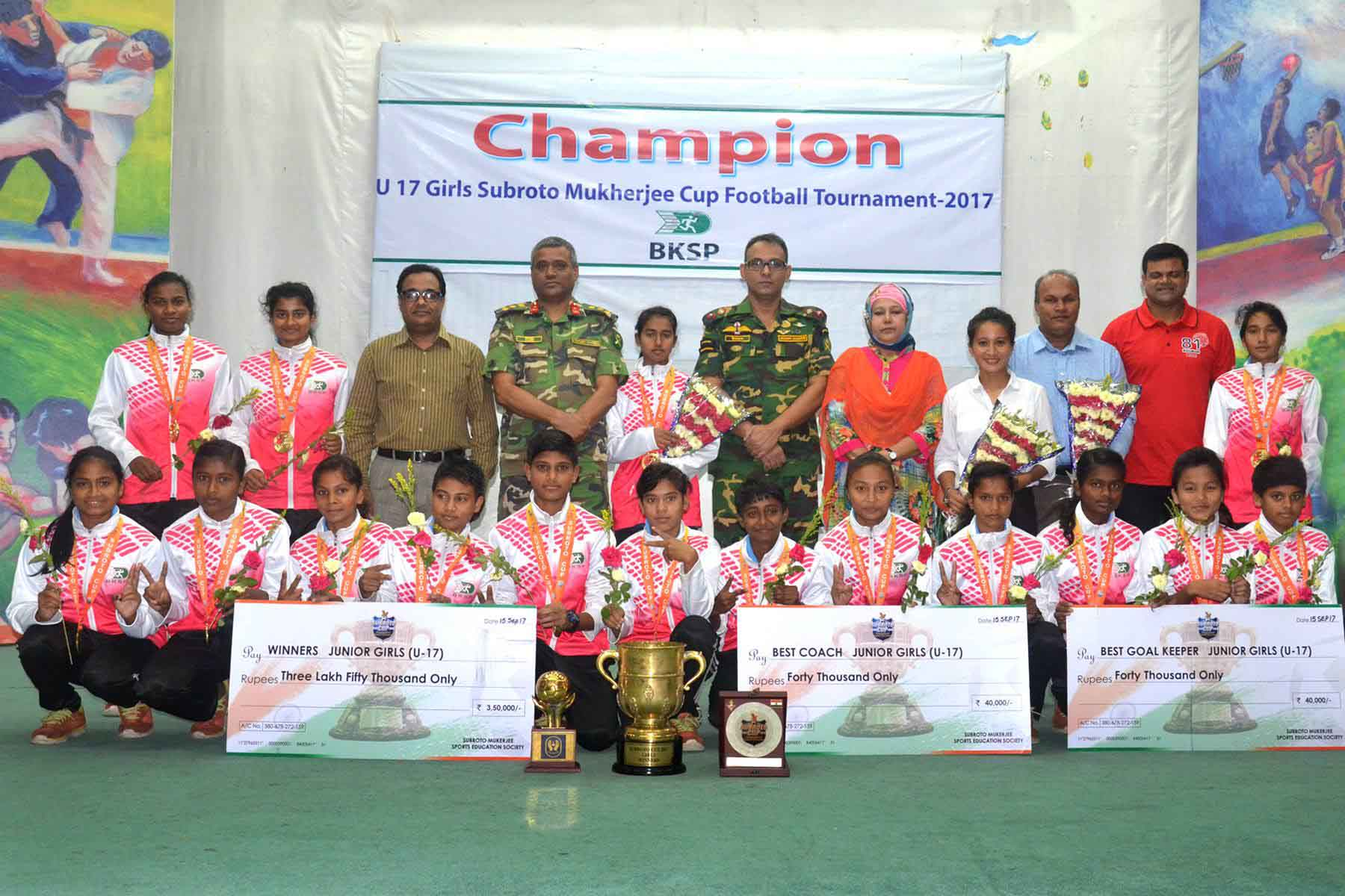 Members of BKSP Under-17 Women's Football team, the champions of the Subroto Mukherjee Cup Under-17 Women's International Football Tournament with the chief guest Director General of BKSP Brigadier General Md Shamsur Rahman and the other officials of BKSP pose for a photo session at BKSP in Savar on Wednesday. BKSP accorded a reception to BKSP Under-17 Women's Football team, which emerged as the champions of the Subroto Mukherjee Cup Under-17 Women's International Football Tournament at New Delhi in India recently.