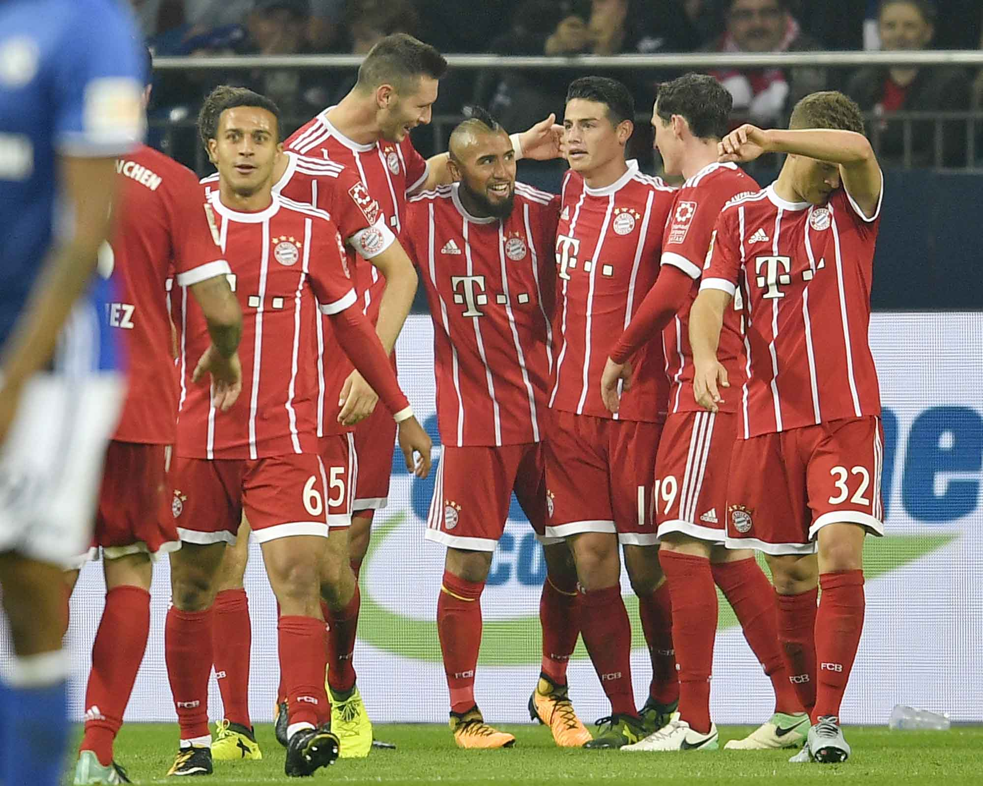 Bayern`s Arturo Vidal is celebrated after he scored the third goal for Bayern during the German Bundesliga soccer match between FC Schalke 04 and Bayern Munich at the Arena in Gelsenkirchen, Germany on Tuesday.