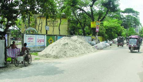 KHULNA: Influentials piled sand and conducting business by grabbing the land of Government BL College . This photo was taken from the main gate of  Collegiate Govt Primary School yesterday.