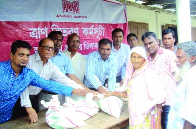 GANGACHARA (Rangpur):  Relief goods were distributed among the flood-hit  people  at Kolkonda Upazila  organised by Anawar Group recently.
