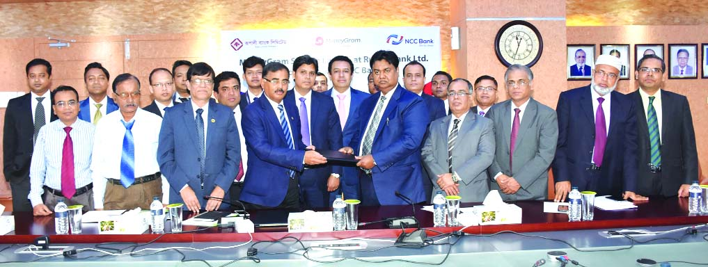 Mosleh Uddin Ahmed, Managing Director of NCC Bank Limited and Md. Ataur Rahman Prodhan, Managing Director of Rupali Bank Limited, exchanging an agreement signing documents at the bank head office on Thursday. Under the deal, Rupali Bank will disburse foreign inward remittance instantly from all its 563 branches across the country collected from 200 countries through MoneyGram remittance service of NCC Bank. Top officials from both the organizations were present.
