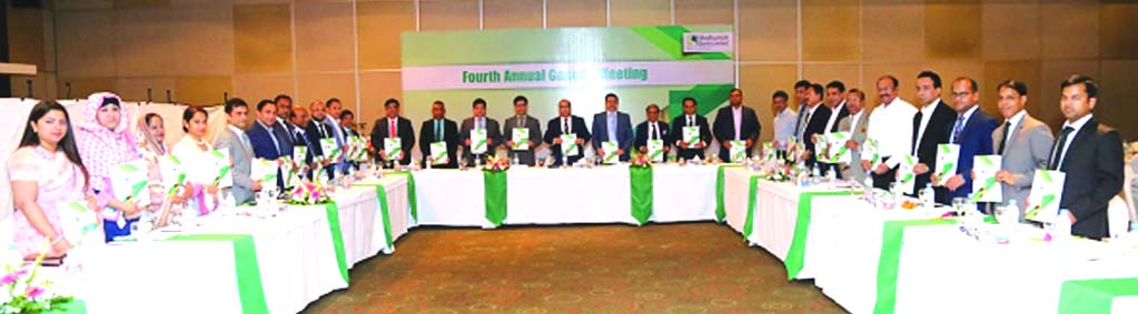 Humayun Kabir, Chairma, Board of Directors of Modhumoti Bank Limited, presiding over its 4th AGM at a city hotel on Thursday. The AGM approved 10percent Cash Dividend for the year 2016. Md. Shafiul Azam, Managing Director, Shaikh Salahuddin, Vice-Chairman, Barrister Sheikh Fazle Noor Taposh MP, EC Chairman and Kazi Ahsan Khalil, DMD of the bank among others were also present.