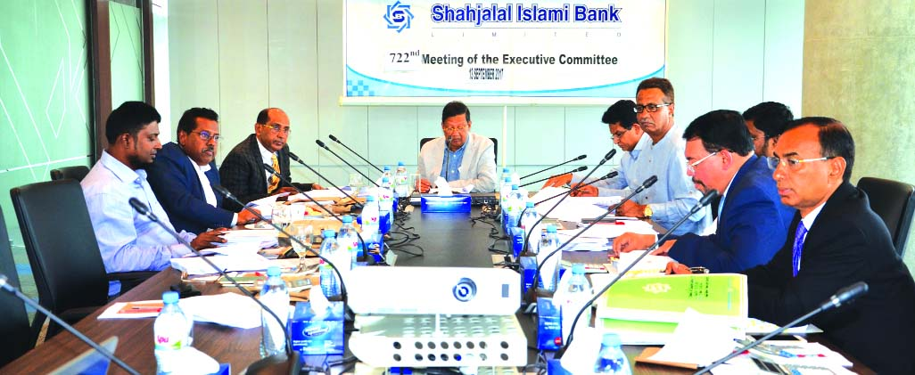 Akkas Uddin Mollah, EC Chairman of Shahjalal Islami Bank Limited, presiding over its 722nd meeting at its head office in the city recently. Engineer Md. Towhidur Rahman, Chairman, Board of Directors, Farman R Chowdhury, Managing Director, AK Azad, Mohammed Younus, Fakir Akhtaruzzaman and Anwer Hossain Khan, Directors of the bank were also present.