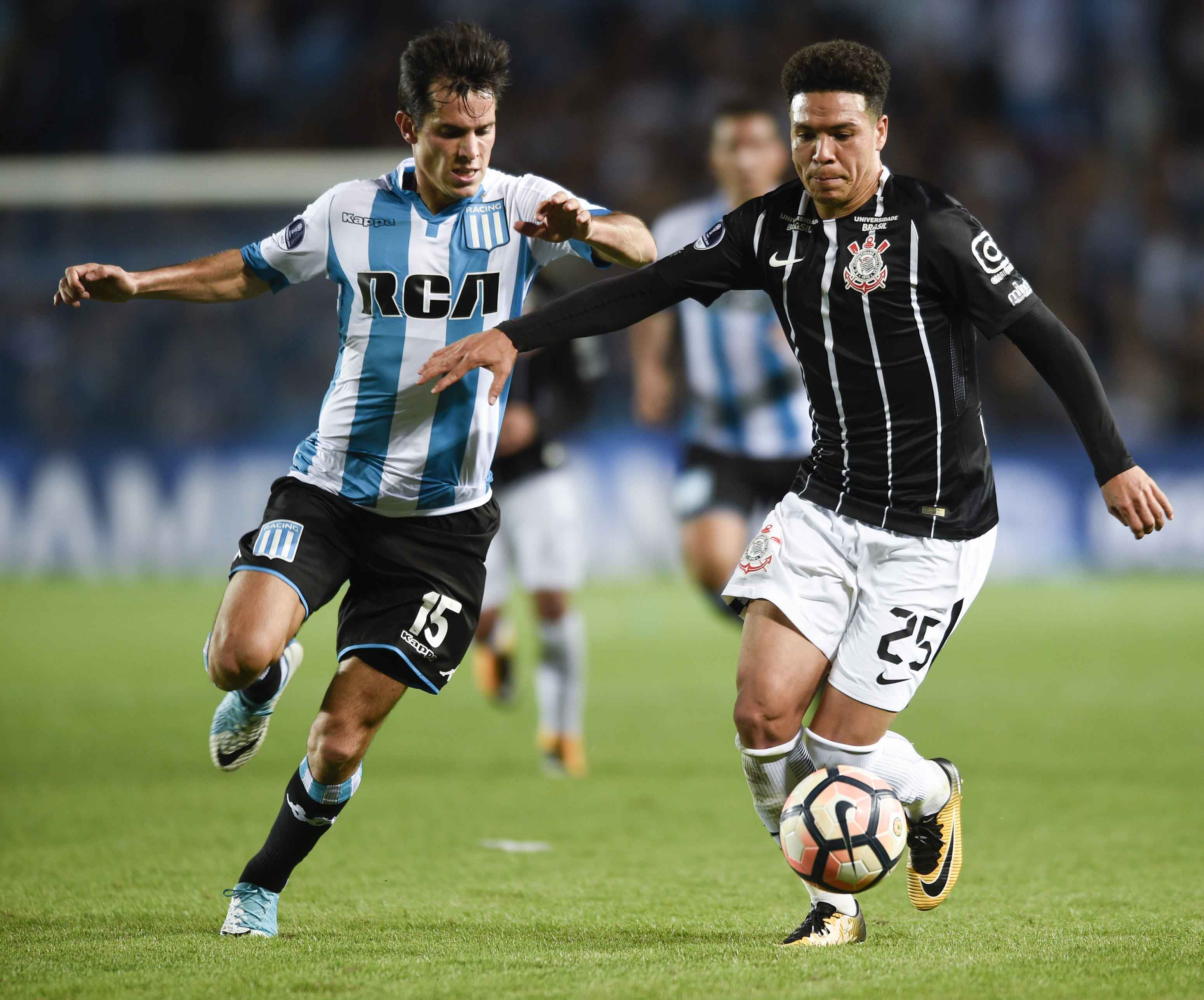 Clayson of Brazil's Corinthians (right) fights for the ball with Augusto Solari of Argentina's Racing during a Copa Sudamericana soccer match in Buenos Aires, Argentina on Wednesday.