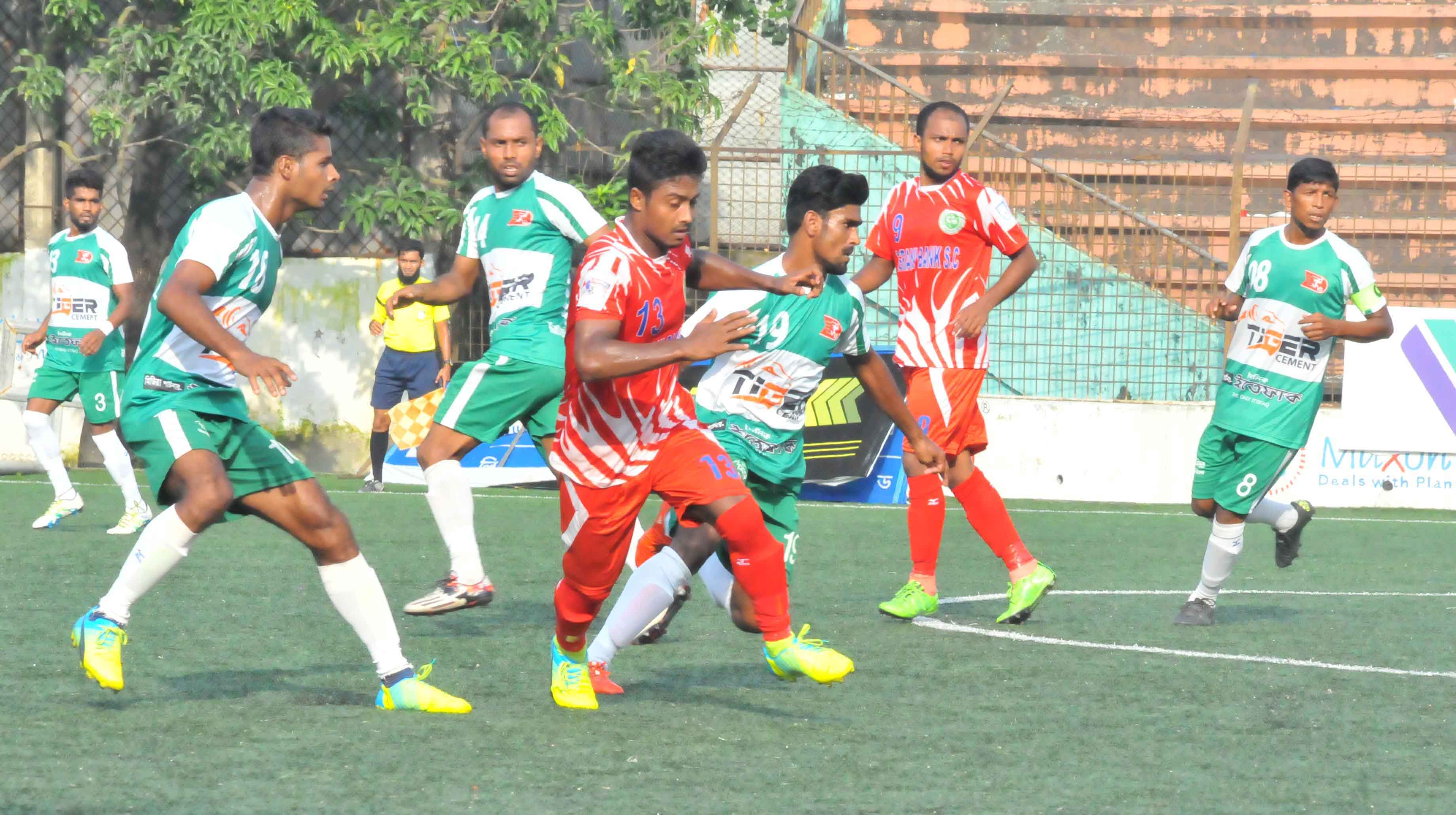 An action from the match of the Marcel Bangladesh Championship League Football between Kawranbazar Progoti Sangha and Agrani Bank Limited Sporting Club at the Bir Shreshtha Shaheed Sepoy Mohammad Mostafa Kamal Stadium in the city's Kamalapur on Thursday. Kawranbazar won the match 3-2.