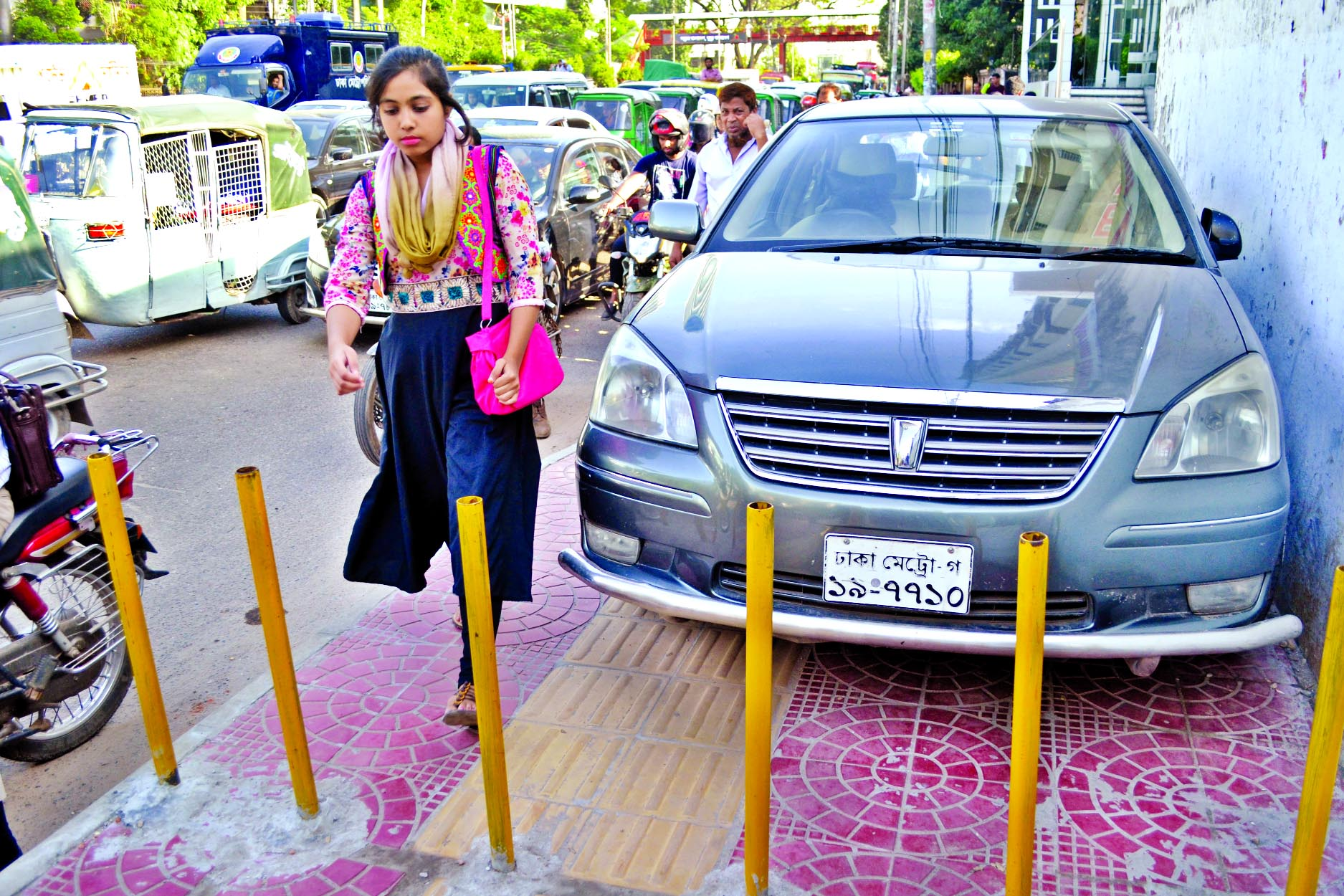 A motorized vehicle parked illegally at a point near the pipe barricade installed by DMP creating obstacle for pedestrians. The snap was taken from the city's Bangla Motor area on Thursday.