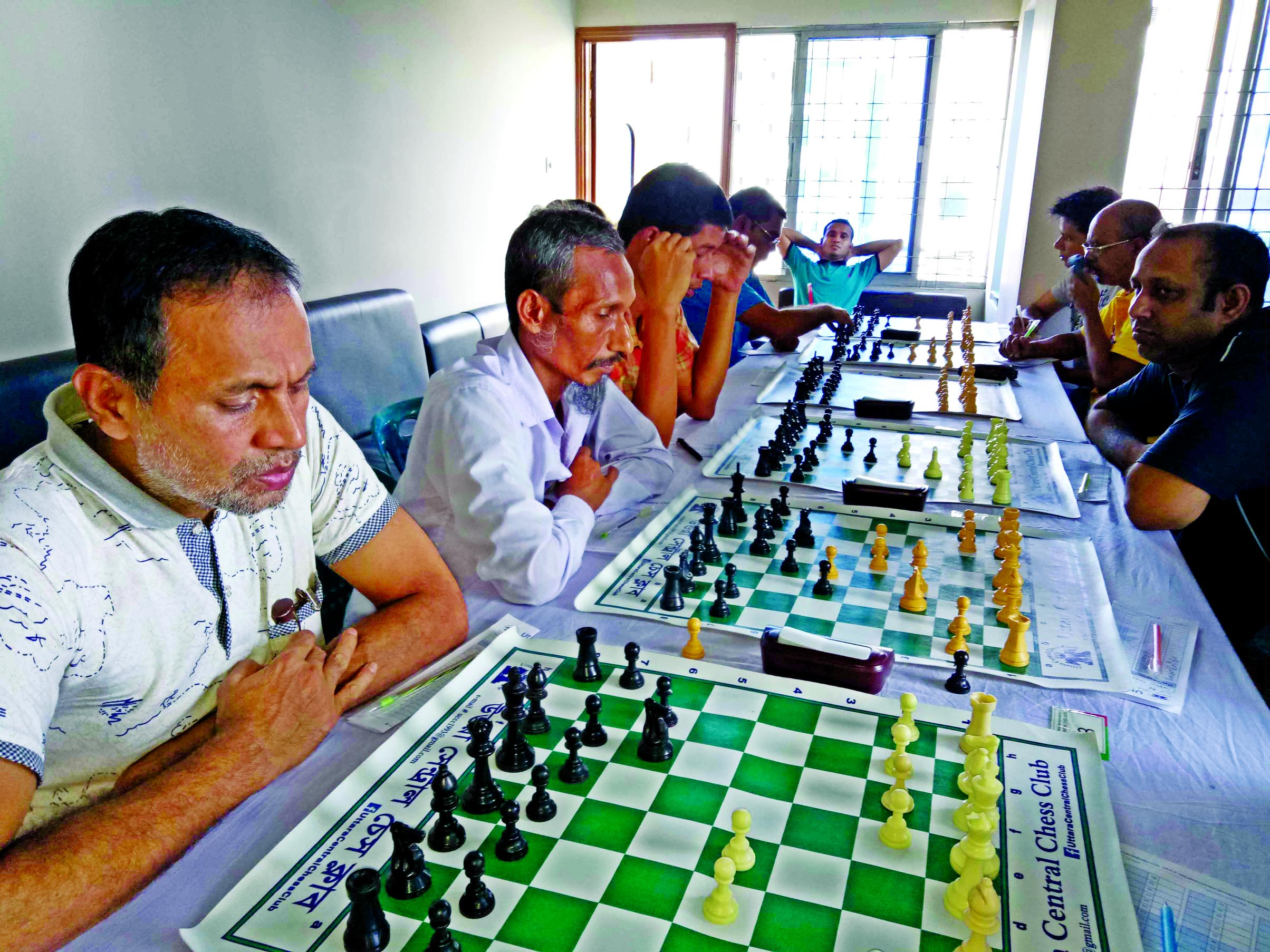 A scene from the sixth round matches of the UCCC Standard Rating Chess Competition at E-Commerce Club hall room in the city's Uttara on Friday.