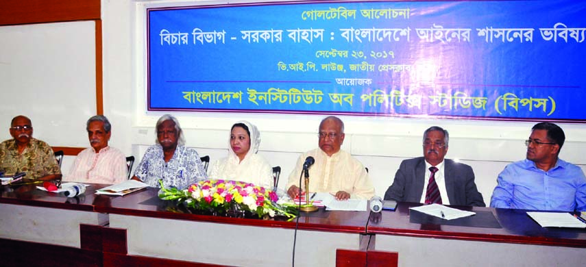 BNP Standing Committee Member Dr Khondkar Mosharraf Hossain speaking at a roundtable on 'Judiciary: Future of Rule of Law in Bangladesh' organised by Bangladesh Institute of Politics Studies at the Jatiya Press Club on Saturday.