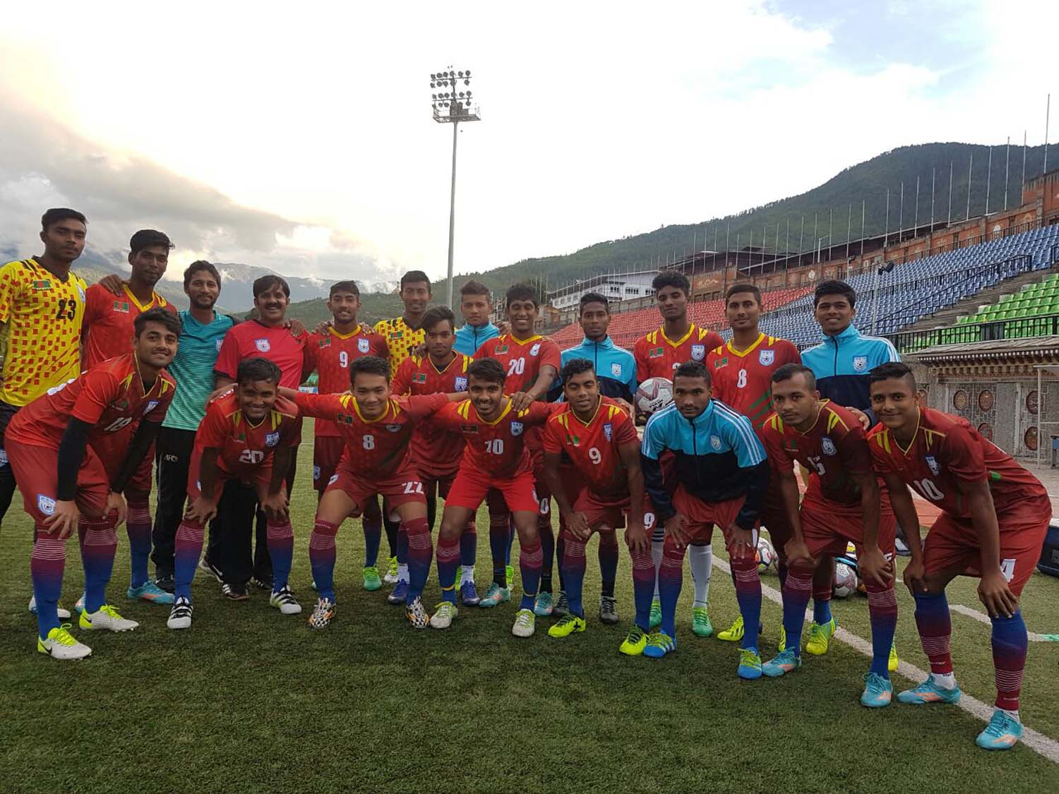 Members of Bangladesh Under-18 National Football team pose for photograph at Thimpu, the capital city of Bhutan on Saturday.