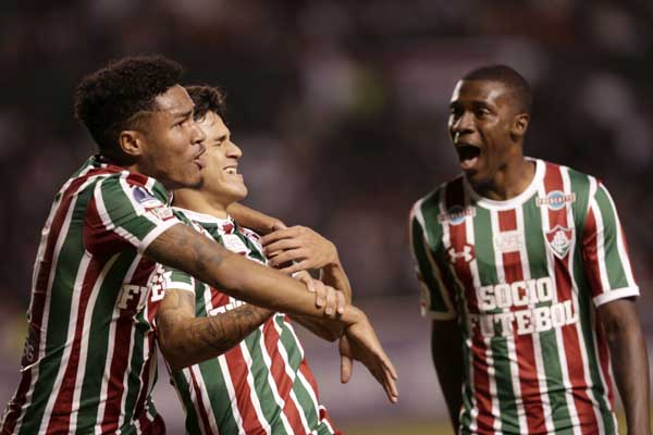 Pedro of Brazil`s Fluminense (center) celebrates with his teammates Douglas (left) and Wesley Frazan, after scoring against Ecuador`s Liga Deportiva Universitaria during a Copa Sudamericana soccer match in Quito, Ecuador on Thursday.