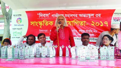 GAZIPUR:  Renowned musician of Swadhin Bangla Betar Kendra Monoranjan Ghosal addressing the 3rd Inter-school Cultural Competition organised by Dibos Foundation at Gacha School premises at Gazipur on Friday.