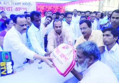 MANIKGANJ: A M Naimur Rahman Durjoy MP distributing relief goods among the flood-hit people at Daulatpur Upazila organised by Bashundhara Group recently.