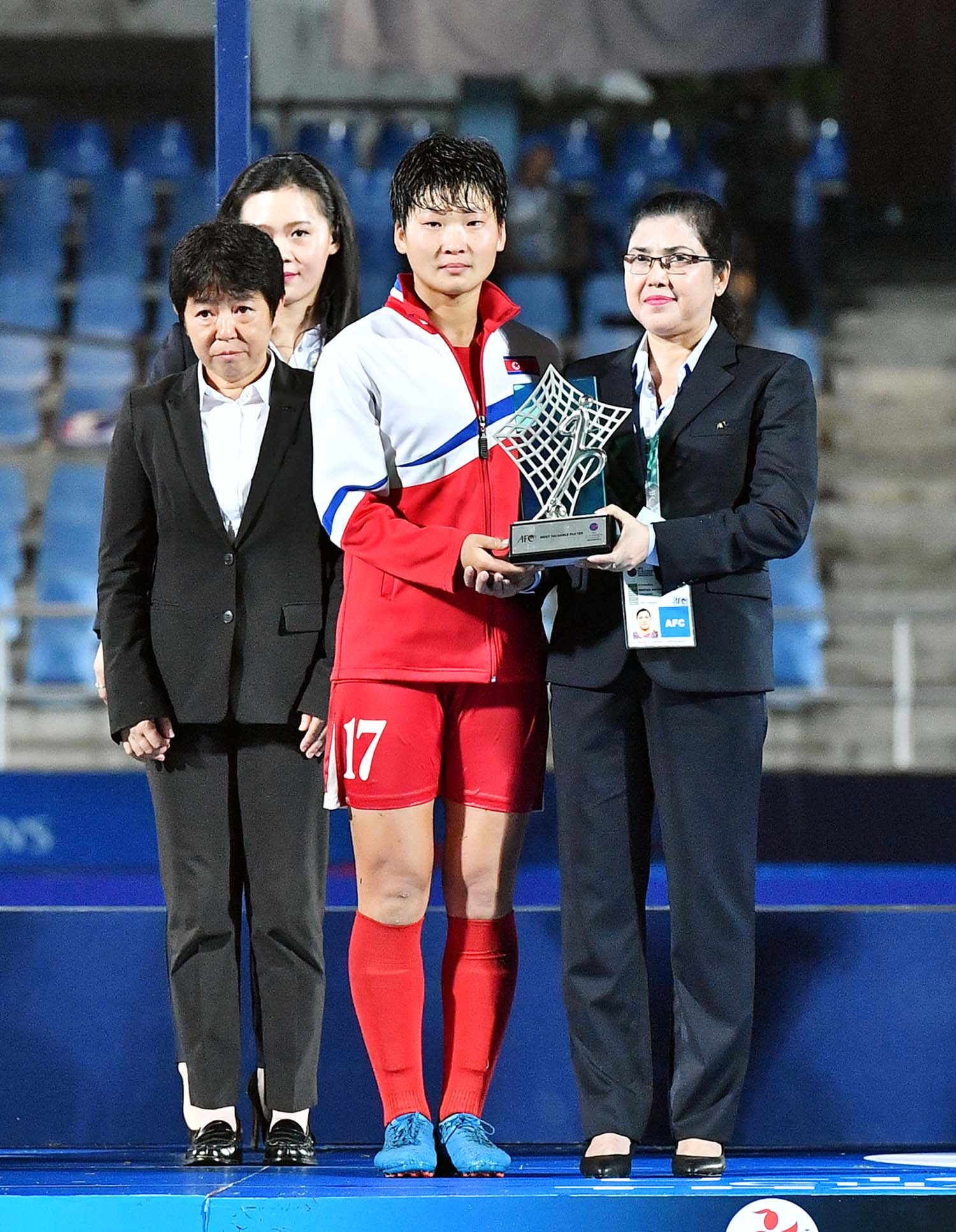 Member of FIFA Mahfuza Akter Kiron handing over the prize to a winner of the AFC Under-16 Women's Championship at Chonburi in Thailand recently.