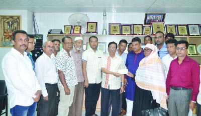 KHULNA: Sheikh Harun-ur-Rashid, Chairman, Khulna Zilla Parishad distributing cheque among the poor and distressed people donated from Prime Minister's Relief Fund  on Sunday.