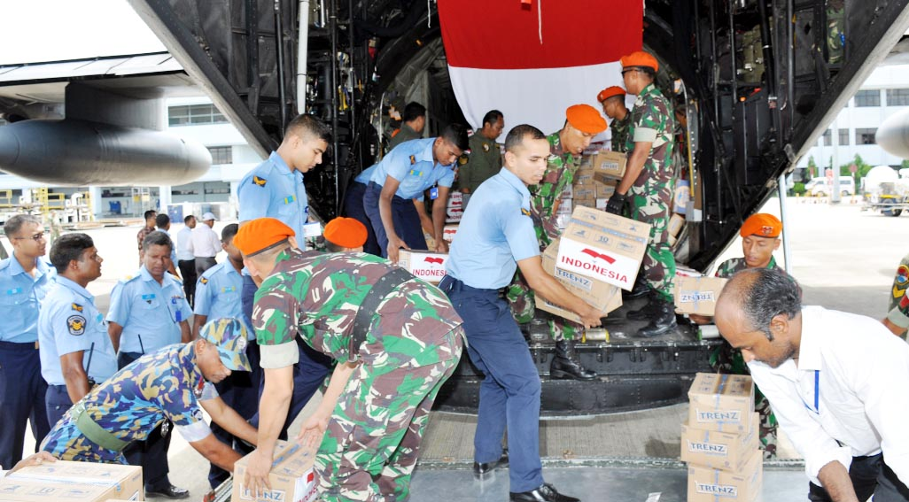 Bangladesh Air Force members unloading foreign relief goods for Rohingyas  at the Port City recently.