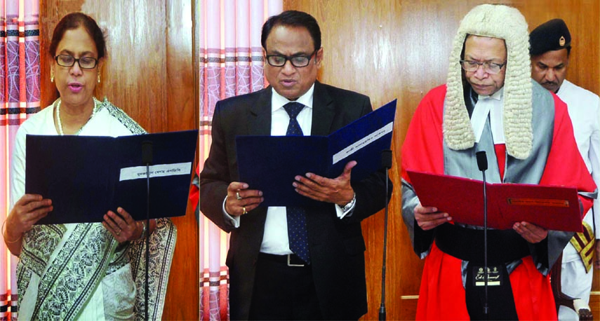 Chief Justice Surendra Kumar Sinha administering oath of office to two newly appointed members of Bangladesh Public Service Commission Nurjahan Begum and Kazi Salahuddin Akbar at the Supreme Court Judges Lounge on Monday.