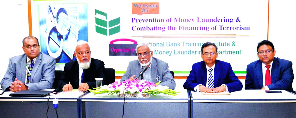 Shah Syed Abdul Bari, DMD of National Bank Limited, presiding over a workshop on