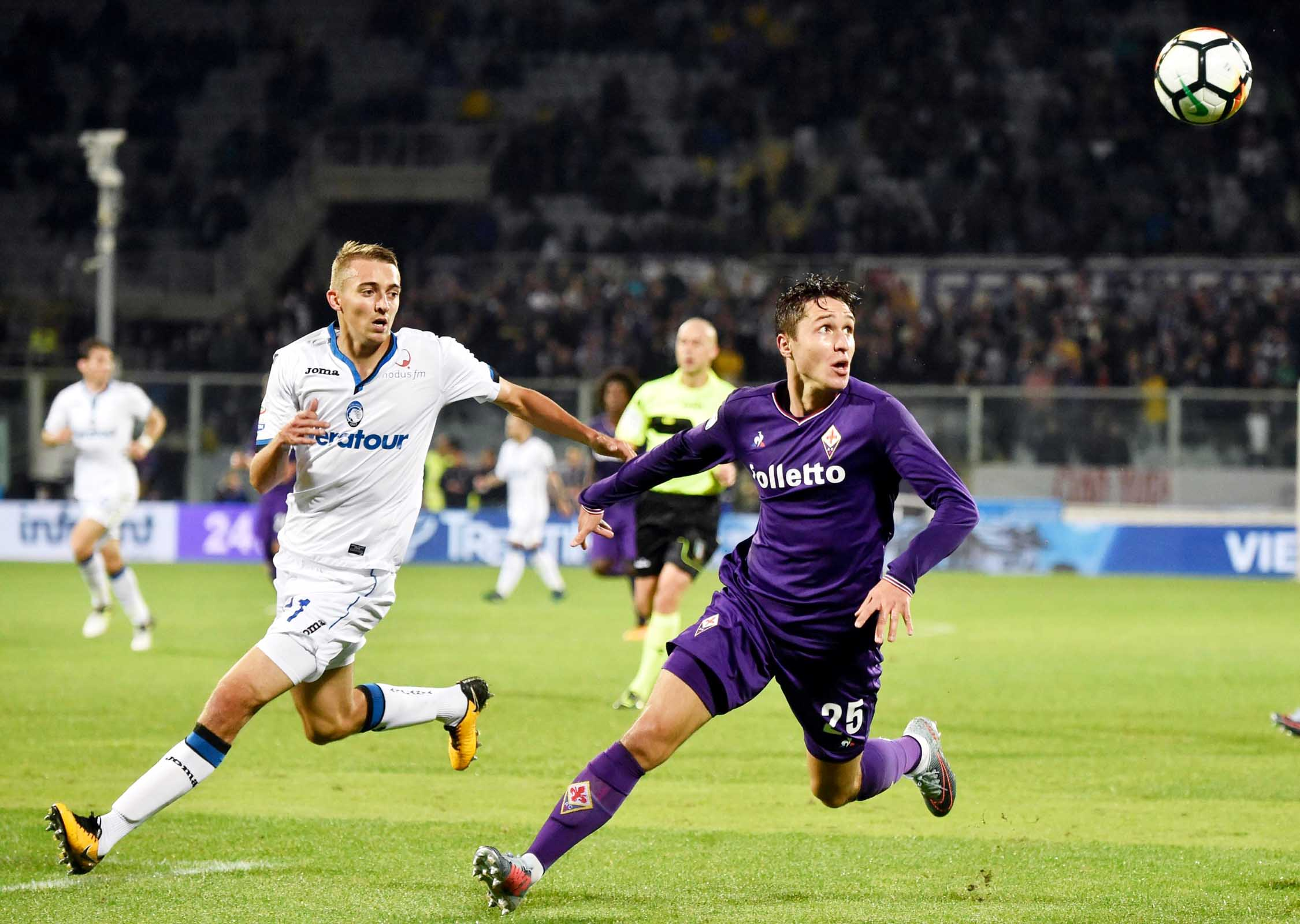 Fiorentina forward Federico Chiesa and Atalanta's Timothy Castagne (left) vie for the ball during the Italian Serie A soccer match between Fiorentina and Atalanta at the Artemio Franchi stadium in Florence, Italy on Sunday.