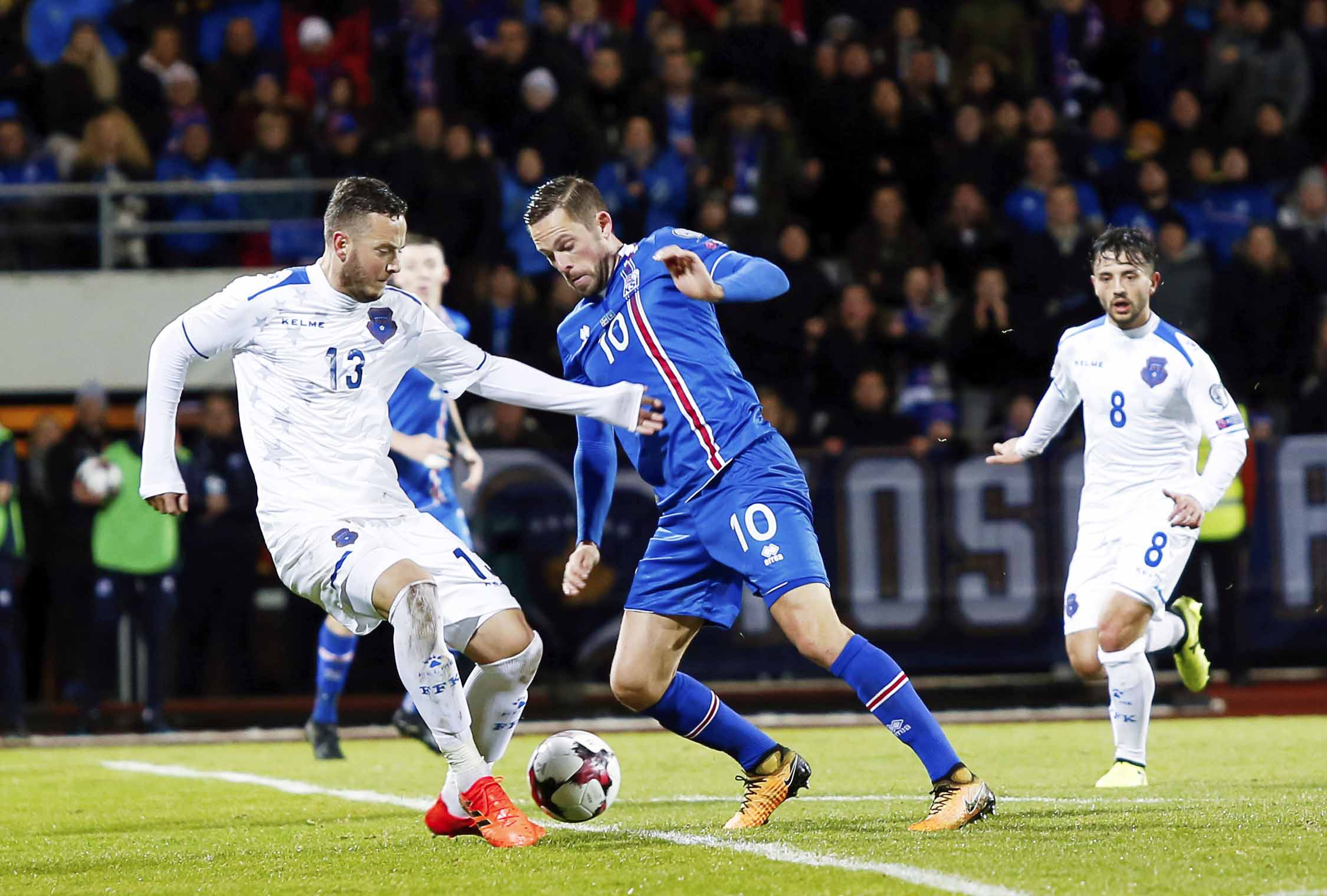 Iceland's Ragnar Ragnusson (right) challenges Kosovo's Dragan Petric for the ball during the World Cup Group I qualifying soccer match between Iceland and Kosovo in Reykjavik, Iceland on Monday.