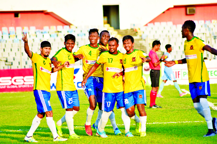 Players of Sheikh Jamal Dhanmondi Club Limited celebrating after scoring a goal against Farashganj Sporting Club in their match of the Saif Power Battery Bangladesh Premier League Football at the Bangabandhu National Stadium on Friday. Sheikh Jamal won the match 5-0.