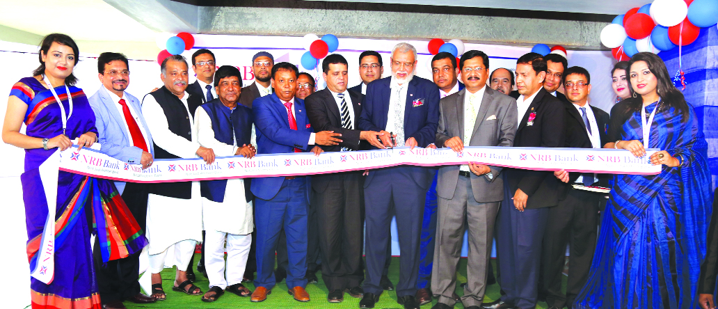 M Badiuzzaman, EC Chairman of NRB Bank Limited, inaugurating its 28th Branch at city's Dhanmondi area on Monday. Md. Mehmood Husain, Managing Director, Tateyama Kabir, Vice-Chairman, Mohammed Idrish Farazy, Chairman of Risk Management Committee and Mohammed Jahed Iqbal, Director of the bank were also present.