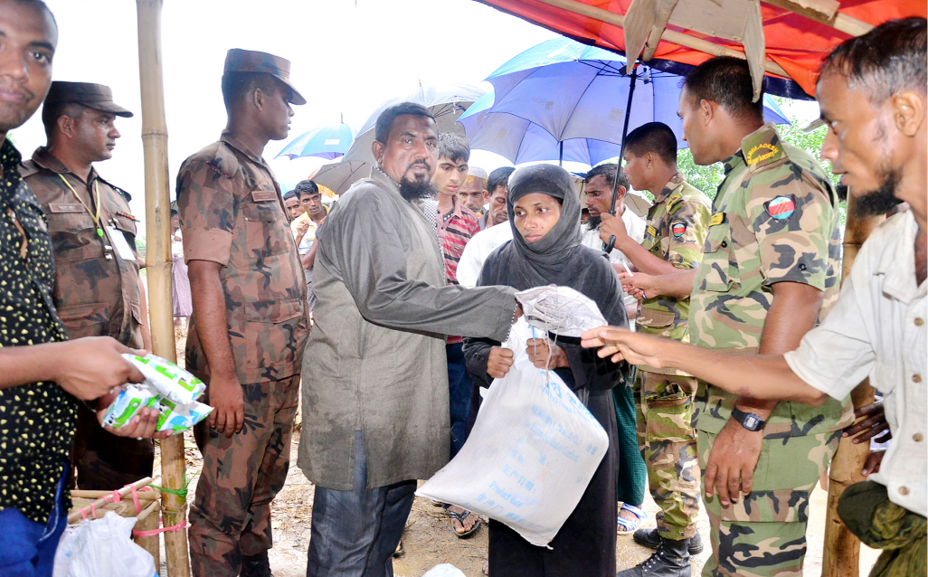 Mir Mohammad Abu Hanif, Vice - President, Bangladesh Shadhinota Parishad distributing relief goods among the Rohingya people  at Ukhiya Upazila recently.