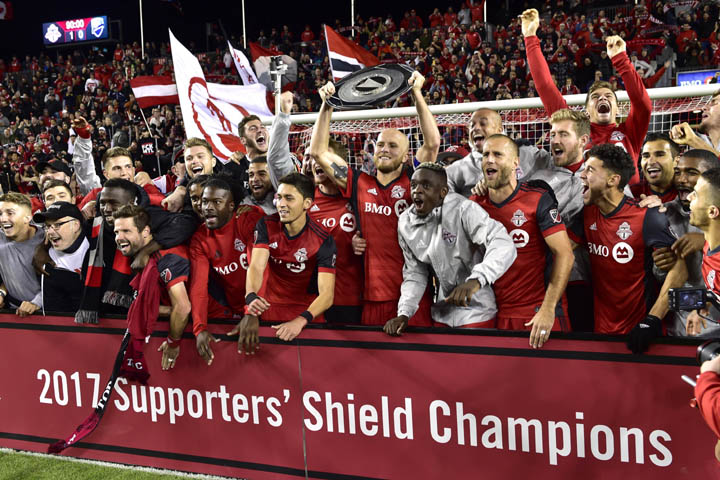 Players of Toronto FC celebrate with the Supporters` Shield following their win over the Montreal Impact in MLS soccer game action in Toronto on Sunday.