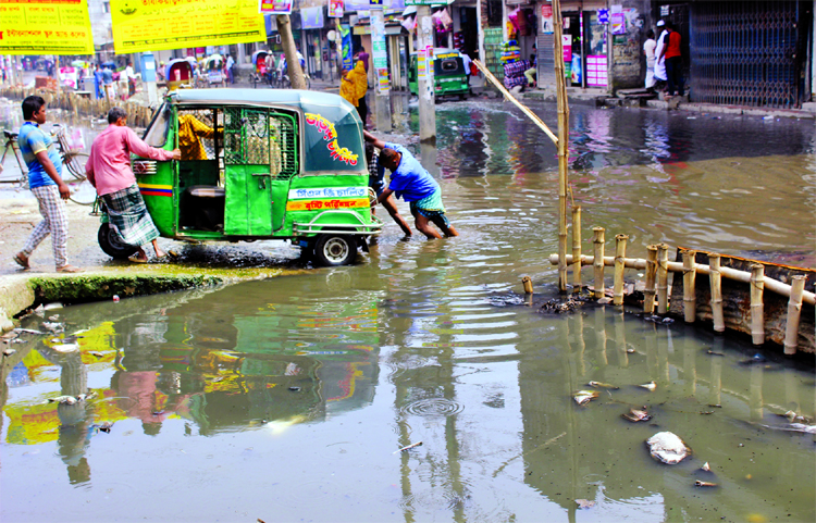 Sewerage waters being logged at city's Dholaiparh area for months together due to poor drainage management causing immense sufferings to commuters and pedestrians as well. This photo was taken on Monday.