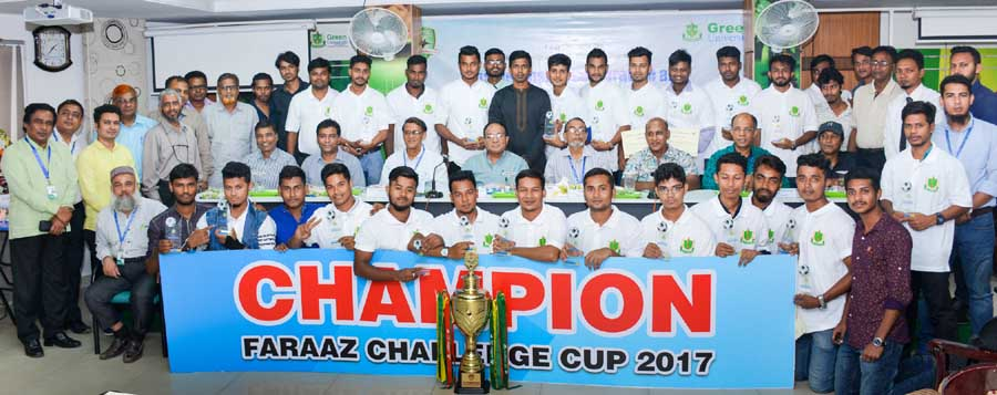 The teachers of Green University and the members of Sonali Otit Club and the Green University Football team, which emerged as the champions of Walton Inter- University Football Tournament (Faraaz Challenge Club) pose for a photo session at the Auditorium of Green University on Tuesday. Officials of Green University accord a reception to Green University Football team.