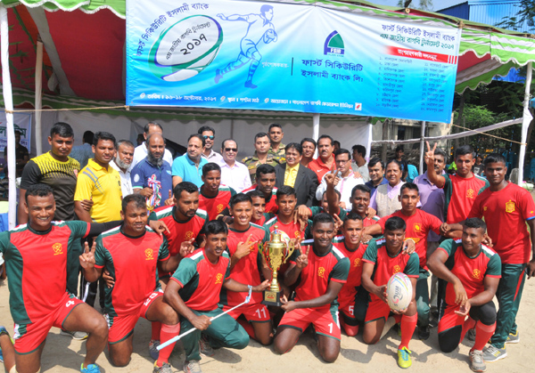 Bangladesh Army, the champions of the 7th First Security Islami Bank National Rugby Competition with the guests and officials of Bangladesh Rugby Union pose for a photo session at the Paltan Maidan on Wednesday.