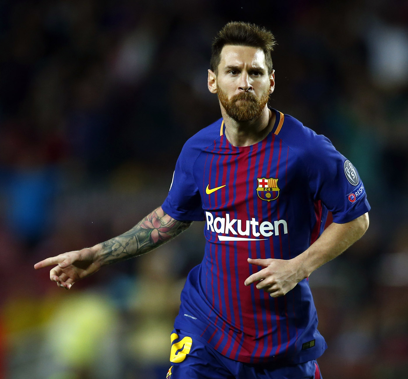 Barcelona's Lionel Messi reacts after scoring during the group D Champions League soccer match between FC Barcelona and Olympiakos at the Camp Nou stadium in Barcelona, Spain on Wednesday.