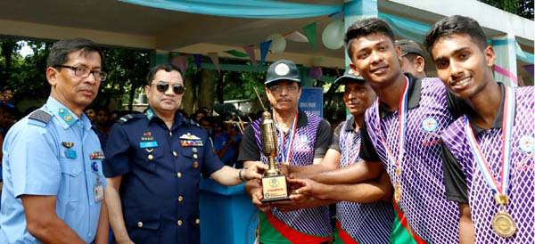 Air Officer Commanding of BAF Base Bashar Air Vice Marshal Ehsanul Gani Choudhury giving away trophy to BAF Shaheen College Dhaka team who won the Inter Shaheen Hockey title at Shaheen College Hockey turf, Dhaka on Wednesday.