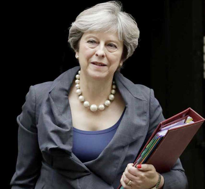 May to urge EU leaders to speed up Brexit talks