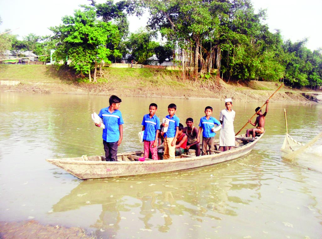 JAMALPUR: People of 30 villages at Melandah Upazila have been using boats to cross  Katakhali River  in absence  of bridge . This snap was taken yesterday.