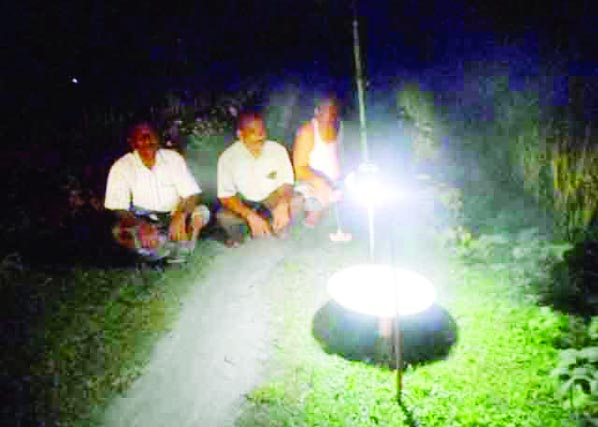 SUNDARGANJ (Gaibandha):  Farmers  at Chhaporhati Zilla para  are identifying inseets in paddy fields by light trap on Thursday night.