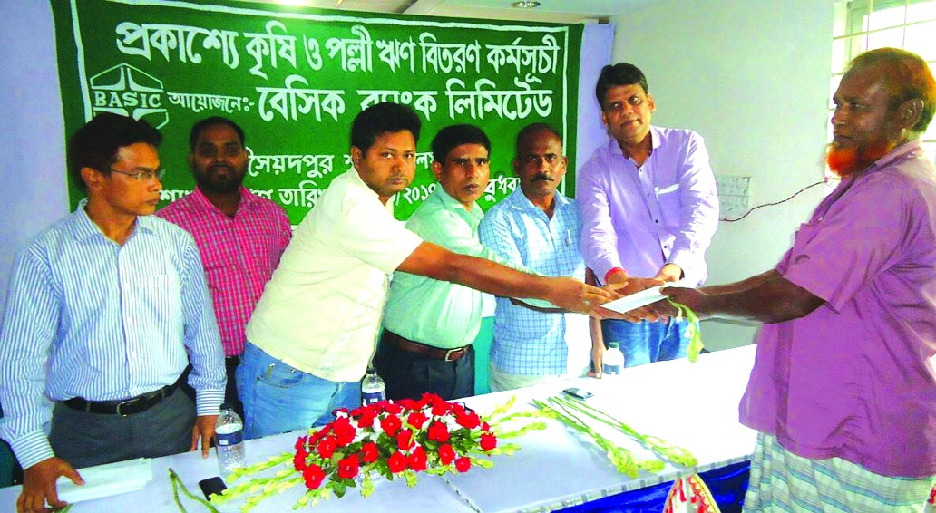 Basic Bank Limited of Saidpur Branch, Nilphamari publicly distributed agricultural loans of Tk 10 lakh among the farmers at  at the branch office of the bank recently. Rajshahi Krishi Unnayan Bank Saidpur Branch Manager Md. Abdus Salam Khan was also present.  Ikhwanul Islam,  assistant general manager and chief of Saidpur branch of the bank presided.