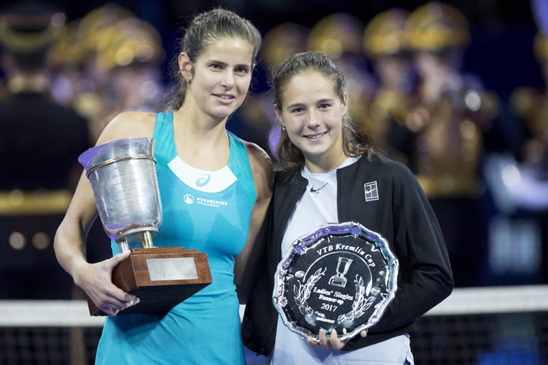 Julia Goerges of Germany poses with the trophy after defeating Daria Kasatkina of Russia (right) in the final match at the Kremlin Cup tennis tournament in Moscow, Russia on Saturday.